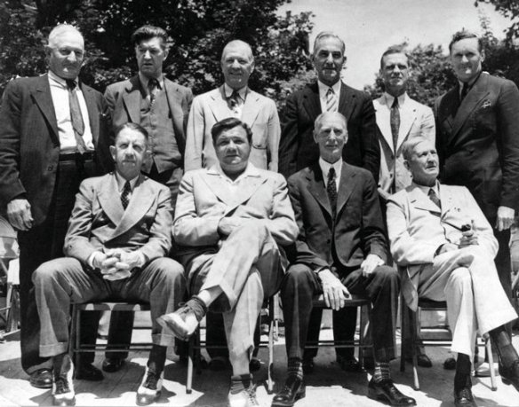 The 1939 National Baseball Hall of Fame induction. Eddie Collins is seated at the left of the front row, next to Babe Ruth.